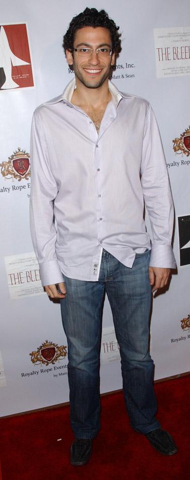 How tall is Adam Tsekhman